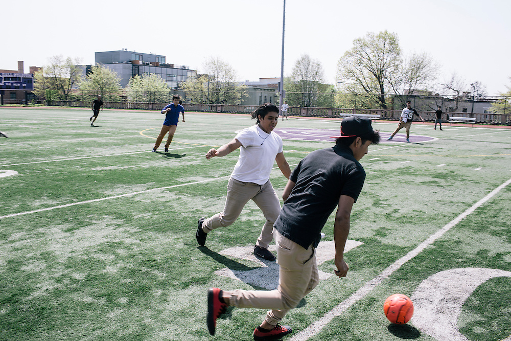 Students in Washington D.C.'s first-year International Academy for English-language learners, including Manuel Ramos, 18, originally from El Salvador, left, and Mauricio Garcia, right, 17, also of El Salvador, play a game of soccer during their lunch hour on the school turf at the International Academy at Cardozo Education Campus on April 22, 2015. The program is aimed at dealing with the influx of unaccompanied minors, mostly from Central American countries, and allows them to be in classes of 25 together. Currently Cardozo, in NW Washington DC has about 200 of these students.