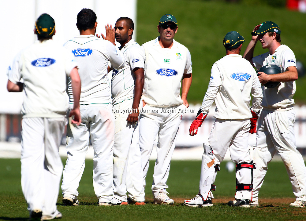 Stags players celebrate a wicket during the Plunket Shield cricket - Wellington Firebirds v Central Stags, day three at Hawkins Basin Reserve, Wellington, New Zealand on Wednesday 30 March 2011. Photo: Justin Arthur / photosport.co.nz