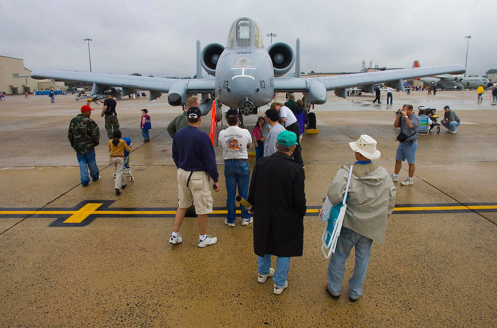 (PSUNDAY) McGuire AFB 6/4/2004  Spectators gather around an A-10 Challenger (please confirm this with Mike Amsel)  EDS:  Due to weather the in air performances were either cancelled or delayed indefinitely until the conditions made it safe to fly. Please also note the crowds were VERY thin.  I did the best I could.   Michael J. Treola Staff Photographer....MJT