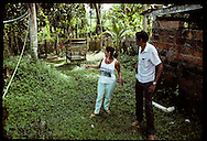 Two rubber tapper unionsts stand beside bathhouse in Chico Mendes backyard where killer hid;Xapuri Brazil