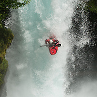 A kayaker drops the 33-foot Spirit Falls during the Little White Salmon Race on the Little White Salmon River Sunday, May 26, 2013.