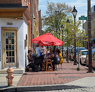 Fells Point, Baltimore, MD, USA -- April 13, 2019. Diners enjoy breakfast outside in Fells Point, Baltimore on a spring morning.