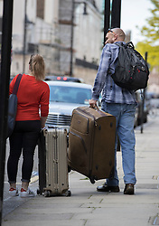 © Licensed to London News Pictures. 24/05/2016. London, UK. Members of Jose Mourinho's staff load suitcases into a car outside his London home. Mourinho is expected to be named as Manchester United manager in the next few days. Photo credit: Peter Macdiarmid/LNP