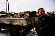 Workers selling firewood at a market in Mitrovica Kosovo. Price is 30euros per square meter.