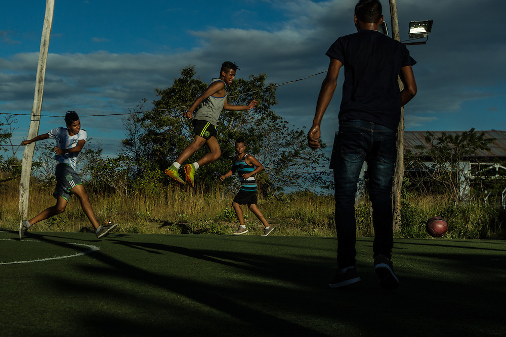 LA CRUZ, COSTA RICA - JANUARY 5, 2016: Cuban migrants pass the time by playing soccer at a temporary migrant shelter at a local fire station near the Costa Rica/Nicaragua border. Nearly 8,000 migrants have been living in shelters in this tiny border town since early November, when Nicaraguan migration authorities denied them entry into their country, as the migrants travelled north with plans of arriving in the United States to take advantage of the1966 Cuban Adjustment Act, which allows Cubans who flee the island to enter the United States and apply for legal residency a year later. Many Cubans fear that this law will be revoked soon, because President Obama restored U.S. diplomatic relations Cuba. The latest wave of Cuban migration is also the result of a number of reforms made on the island that made it possible for homeowners to sell their properties, a move that triggered an exodus, because many more people could gather the funds to pay smugglers. Cuba also allowed its citizens to obtain passports and travel freely. PHOTO: Meridith Kohut for The New York Times