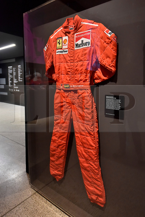 """© Licensed to London News Pictures. 14/11/2017. London, UK.  Racing suit worn by Michael Schumacher to win the 1996 Italian Grand Prix.  Preview of """"Ferrari: Under the Skin"""", an exhibition at the Design Museum to mark the 70th anniversary of Ferrari.  Over GBP140m worth of Ferraris are on display from private collections including Michael Schumacher's 2000 F1 winning car.  The exhibition runs 15 November to 15 April 2018.  Photo credit: Stephen Chung/LNP"""