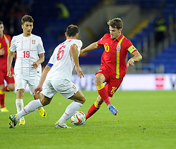 Aaron Ramsey (C) of Wales (Arsenal) battles for the ball with Branislav Ivanovic of Serbia (Chelsea)  - Photo mandatory by-line: Joe Meredith/JMP - Tel: Mobile: 07966 386802 10/09/2013 - SPORT - FOOTBALL - Cardiff City Stadium - Cardiff -  Wales V Serbia- World Cup Qualifier