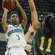 UNCW's Kelva Atkins shoots over William and Mary's Alexandra Masaquel Sunday January 4, 2015 at Trask Coliseum on the campus of UNCW. (Jason A. Frizzelle)