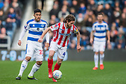 Joe Allen (Stoke) with the ball during the EFL Sky Bet Championship match between Queens Park Rangers and Stoke City at the Loftus Road Stadium, London, England on 9 March 2019.