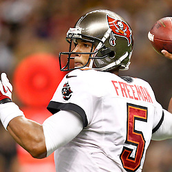 December 16, 2012; New Orleans, LA, USA; Tampa Bay Buccaneers quarterback Josh Freeman (5) throws against the New Orleans Saints during the second half of a game at the Mercedes-Benz Superdome. The Saints defeated the Buccaneers 41-0. Mandatory Credit: Derick E. Hingle-USA TODAY Sports