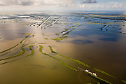 The Mississippi Delta has over 10,000 miles of canals dug to tap oil and natural gas.  The canals and drilling are blamed in part for the loss of more than 1,000 square miles of wetlands through the interruption of tidal flows, salt water infiltration, and subsidence.