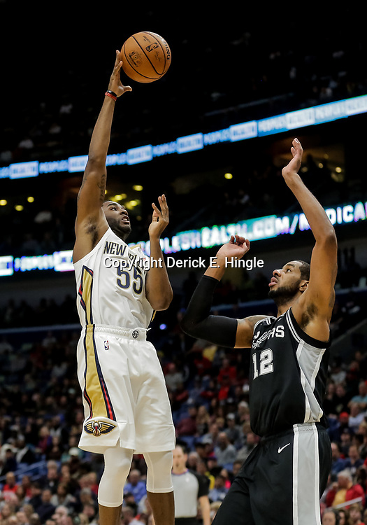 Nov 19, 2018; New Orleans, LA, USA; New Orleans Pelicans guard E'Twaun Moore (55) shoots over San Antonio Spurs forward LaMarcus Aldridge (12) during the first quarter at the Smoothie King Center. Mandatory Credit: Derick E. Hingle-USA TODAY Sports