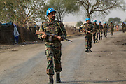 UNMISS peacekeepers carrying out a foot patrol in Pibor market as part of their activities to protect civilians following outbreak of violence. 6 March 2013. Photo by UNMISS Martine Perret