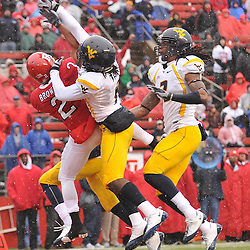 Dec 5, 2009; Piscataway, NJ, USA; West Virginia defensive back Keith Tandy (8) deflects a pass away from Rutgers wide receiver Tim Brown (2) during second half NCAA Big East college football action in West Virginia's 24-21 victory over Rutgers at Rutgers Stadium.