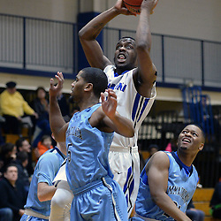 DAILY TIMES - TOM KELLY IV<br /> Cabrini's Aaron Walton-Moss (2) goes up for a layup past Immaculata's Rodney Duncan (5) and Mike Sturdivant (24) during the Immaculata at Cabrini men's basketball game on Wednesday, January 7, 2014.