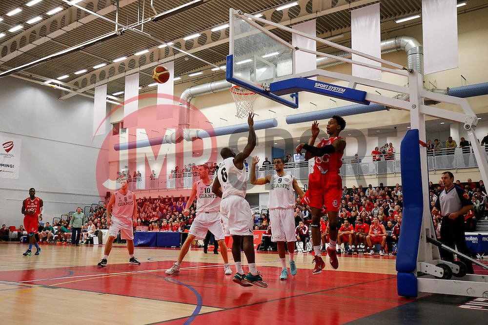 Bryquis Perine of Bristol Flyers is challenged by Stefan Gill of Manchester Giants - Photo mandatory by-line: Rogan Thomson/JMP - 07966 386802 - 07/02/2015 - SPORT - BASKETBALL - Bristol, England - SGS Wise Arena - Bristol Flyers v Manchester Giants - BBL Championship.
