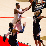 22 December 2018: San Diego State Aztecs forward Matt Mitchell (11) drives through the lane for a basket against Brigham Young Cougars forward Gavin Baxter (25) in the first half. The Aztecs beat the Cougars 90-81 Satruday afternoon at Viejas Arena.