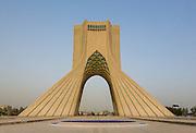The Azadi Tower at dusk, Tehran, Iran. Built: 1971. Architect: Hossein Amanat