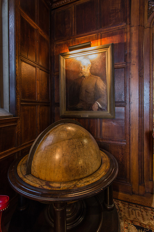 The members' lounge of the Explorers Club features the globe used by Thor Heyerdahl when planning his Kon Tiki expedition. Above it is a portrai of Arctic explorer Adolphus Greely, the Club's first President.