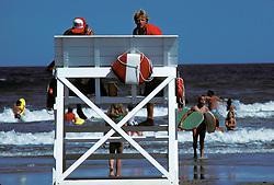 Life guard, shore patrol member checks bathers in surf on the beach in Stone Harbor, NJ.