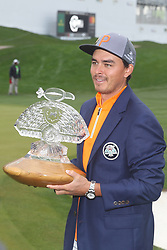 February 3, 2019 - Scottsdale, AZ, U.S. - SCOTTSDALE, AZ - FEBRUARY 03: Rickie Fowler holds the trophy and wears the Thunderbirds jacket after winning the Waste Management Phoenix Open on February 3, 2019, at TPC Scottsdale in Scottsdale, Arizona. (Photo by Will Powers/Icon Sportswire) (Credit Image: © Will Powers/Icon SMI via ZUMA Press)