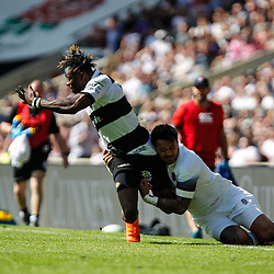 Semi Radradra of the Barbarians and Denny Solomona of England