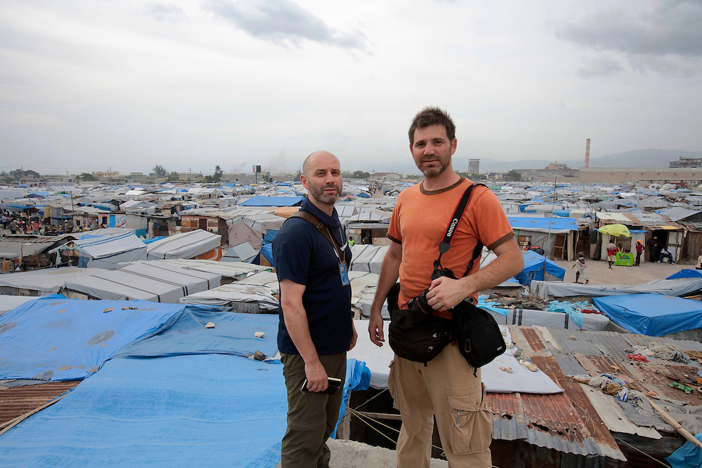 Giuseppe Di Grazia(left) and Nadav Neuhaus(right) in the makeshift refugee camp, La Piste, in Port-au-Prince, Haiti on July 15, 2010. La Piste (French for &quot;runway&quot;)is a settlement sprawled across the site of a disused airport and now home to an estimated 20,000 earthquake survivors living in makeshift structures.<br /> Six month after a catastrophic earthquake measuring 7.3 on the Richter scale hit Haiti on January 13, 2010, killing an estimated 230,000 people, injuring an estimated 300,000 and making homeless an estimated 1,000,000.