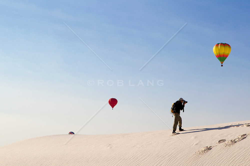 photographer at a hot air balloon festival in White Sands National Park in New Mexico