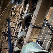 Some of the many Carillon bells that chime in the tower of the Belfry of Bruges. The Belfry (or Belfort) is a medieval bell tower standing above the Markt in the historic center of Bruges. The first stage was built in 1240, with further stages on top built in the late 15th century. The Carillon consists of 47 bells. 26 bells were cast by Georgius Dumery between 1742 and 1748 and 21 bells were cast by Koninklike Eijsbouts in 2010. The bourdon weights 6 tons, and the bells have a combined weight of 27 tons.