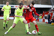 Crawley Town Striker Liam McAlinden (11) battles for the ball with Hartlepool United defender Matthew Bates (6) during the Sky Bet League 2 match between Crawley Town and Hartlepool United at the Checkatrade.com Stadium, Crawley, England on 19 March 2016. Photo by Andy Walter.