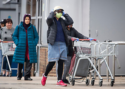 © Licensed to London News Pictures. 30/04/2020. Watford, UK. Shoppers wearing face masks queue to enter Sainsbury's Supermarket on Ladbroke Grove, West London. Sainsbury's today announced that customers are likely to see disruption to their shopping until September as a result of the COVID-19 outbreak. credit: Ben Cawthra/LNP