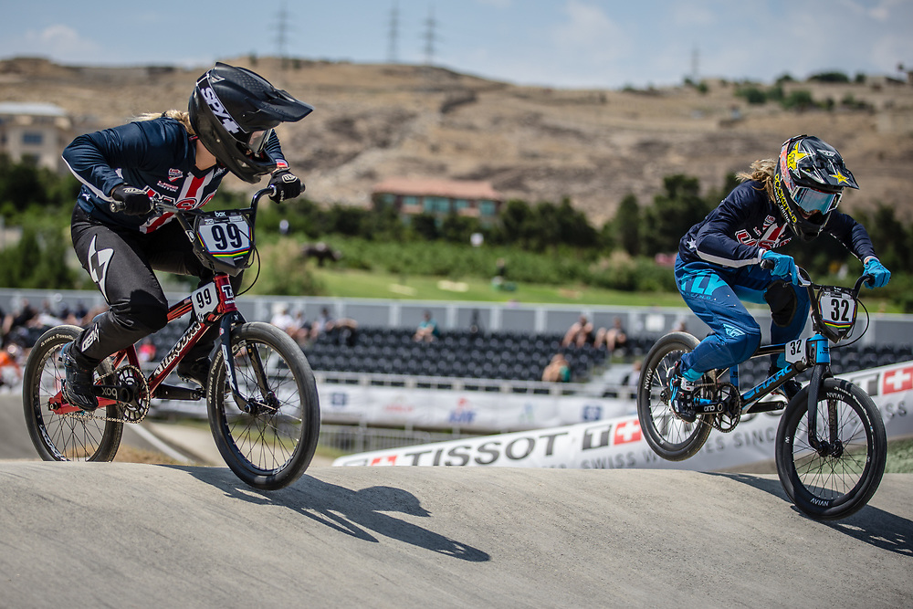 Women Elite #99 (GEORGE Danielle) USA and Women Elite #32 (CRAIN Brooke) USA at the 2018 UCI BMX World Championships in Baku, Azerbaijan.