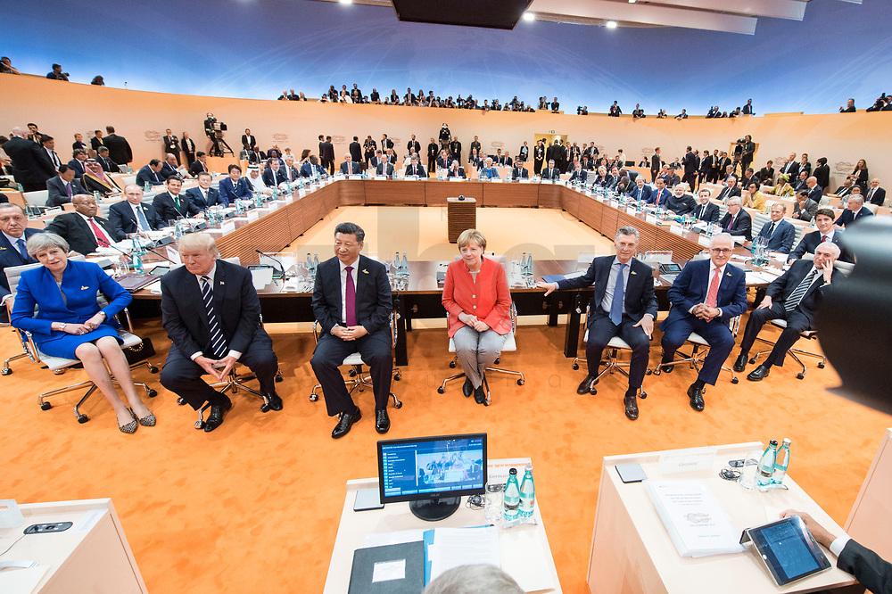 07 JUL 2017, HAMBURG/GERMANY:<br /> Recep Tayyip Erdogan, Praesident Tuerkei, Theresa May, Premierministerin Gross Britannien, Donald Trump, Praesident Vereingte Staaten von Amerika, USA, Xi Jinping, Praesident Volksrepublik China, Angela Merkel, CDU, Bundeskanzlerin, Mauricio Macri, Praesident Argentinien, Malcolm Turnbull, Premierminister Australien, Michel Temer, Praesident Brasilien, (vorne v.L.n.R.), vor Beginn der 1. Arbeitssitzung, G20 Gipfel, Messe<br /> IMAGE: 20170707-01-011<br /> KEYWORDS: G20 Summit, Deutschland, Gespräch
