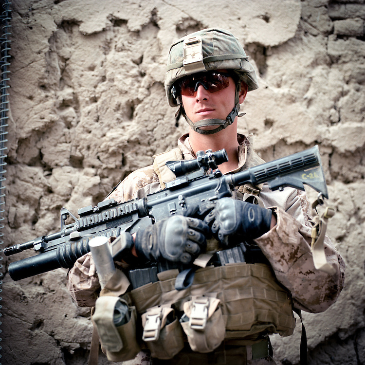 Location:<br /> Patrol Base Fires, Sangin District, Helmand Province, Afghanistan<br /> <br /> Unit: <br /> 3rd Squad, 1st Platoon, Bravo Company, 1st Battalion, 5th Marines<br /> <br /> Name and Rank: Corporal Michael Minor<br /> <br /> Age: 25<br /> <br /> Hometown: Sea Grove, North Carolina<br /> <br /> Why did you join the Marine Corps?<br /> <br /> &quot;You can ask my mom, when I was a little kid I always wanted to join the Army or something. I figured if you&rsquo;re gonna join something, why not the hardest?&quot;<br /> <br /> Describe what it's been like in Sangin so far?<br /> <br /> &quot;When we first got here nothing really happened, then we started getting shot at a little bit. We took a mass cas July ninth, lost a buddy of mine, Lance Corporal O&rsquo;Brien. Then three days later we took another mass cas, lost another buddy of mine, Lance Corporal McDaniels, who was our engineer, he was sweeping. Lost a friend of mine, Elliott. He&rsquo;s a machinegunner, lost his leg. Then no more than thirty to forty-five minutes later, we took another mass cas, lost the other engineer, Baucher. Lost the platoon sergeant, lost our CO . . .&quot;<br /> <br /> What's it like going up against the IED threat?<br /> <br /> &quot;Well no matter where you go it&rsquo;s always gonna be dangerous if someone&rsquo;s trying to kill you. I mean, here, the biggest threat&rsquo;s IEDs. I mean, getting shot at, hell, these guys aren&rsquo;t marksmen around here. They can shoot at me all day long and I wouldn&rsquo;t give a shit.<br /> <br /> IEDs is a completely different story because they&rsquo;re making &lsquo;em out of non-metallic devices and stuff like that, because we have metal detectors that usually picks up the rods and stuff they use in it, but they&rsquo;re using carbon rods from the batteries themselves. What they&rsquo;ll do is throw it in the fire and put a lid over it so that when the battery explodes, the acid doesn&rsquo;t get everywhere. They&rsquo;ll remove the lid then grab the carbon rod, and it&rsquo;s really hard for the metal detector to pick up carbon rods . . .<br /> <br /> &quot;Psychologically? You&rsquo;re out there constantly like, 'Man, am I gonna lose my leg today? Am I gonna lose my life?' Yo