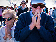 23 JANUARY 2011 - PHOENIX, AZ:  People bow their head in prayer at the invocation during the March for Life through Phoenix, AZ, Sunday. About 500 people participated in the pro-life march and rally, which marked the 38th anniversary of the US Supreme Court's Roe vs. Wade decision, which legalized abortion in the United States.     PHOTO BY JACK KURTZ