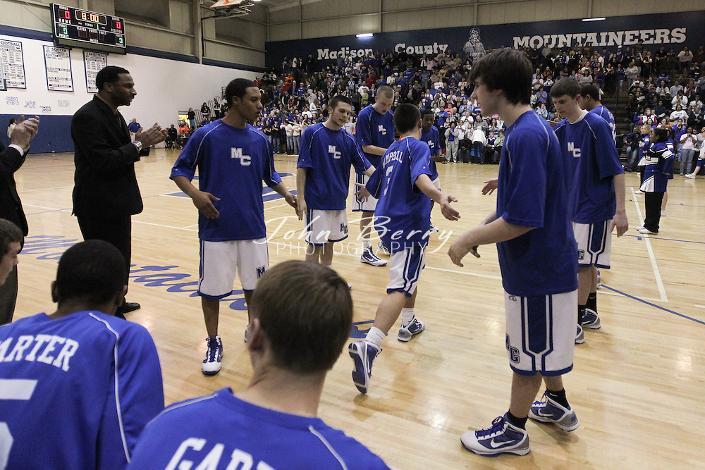 Date:  February/19/10, Bull Run Varsity Basketball District Finals, Madison Mountaineers vs George Mason Mustangs, Madison wins the District Tourney 45-42 over George Mason.  Madison Coach Ben Breeden is Bull Run District Coach of the Year, Logan Terrell is Player of the Year.  David Falk and Jerel Carter elected to first team all district, Matt Garr to second team all district.