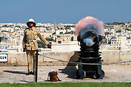 A young gunner fires Malta's noon cannon to mark the midday hour. The noon gun salute is an old naval tradition that was re-established in 2004 and occurs daily from the Saluting Battery in the Maltese capital, Valletta. The cannon is a modified replica of an English SBBL 32 pounder gun and is also fired at 16:00 daily.