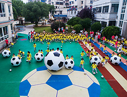 June 20, 2017 - Children play a game with footballs during a football festival at the Central Kindergarten in Changxing County, east China's Zhejiang Province. (Credit Image: © Xu Yu/Xinhua via ZUMA Wire)