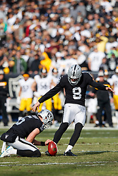OAKLAND, CA - DECEMBER 09: Place kicker Daniel Carlson #8 of the Oakland Raiders kicks an extra point against the Pittsburgh Steelers during the first quarter at the Oakland Coliseum on December 9, 2018 in Oakland, California. The Oakland Raiders defeated the Pittsburgh Steelers 24-21. (Photo by Jason O. Watson/Getty Images) *** Local Caption *** Daniel Carlson