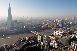 © Licensed to London News Pictures. 27/02/2019. London, UK. Smog is seen over the skyline of London this morning, following days of unseasonably warm weather in the capital. Temperatures on Tuesday 26 February reached 20.8C in Porthmadog, north-west Wales, which was the warmest winter day on record. Photo credit : Tom Nicholson/LNP