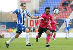 Shaquile Coulthirst of Peterborough United in action with Craig Morgan of Wigan Athletic - Mandatory byline: Joe Dent/JMP - 05/03/2016 - FOOTBALL - DW Stadium - Wigan, England - Wigan Athletic v Peterborough United - Sky Bet League One