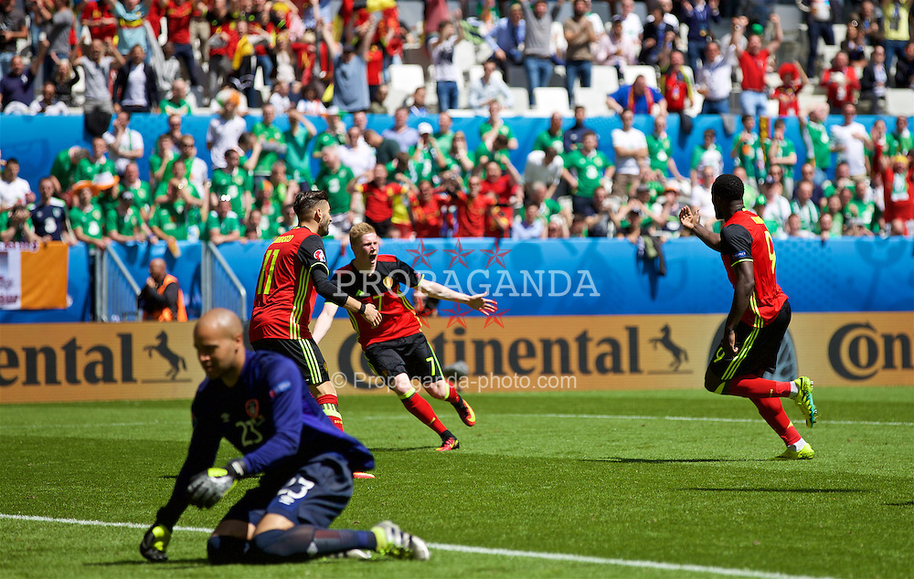 BORDEAUX, FRANCE - Saturday, June 18, 2016: Belgium's Romelu Lukaku celebrates scoring his first goal with Kevin De Bruyne and Yannick Ferreira Carrasco to make the score 1-0 during the UEFA Euro 2016 Championship Group E match against the Republic of Ireland at Stade de Bordeaux. (Pic by Paul Greenwood/Propaganda)