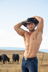 sexy shirtless muscular cowboy on a cattle ranch