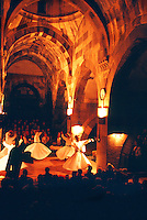 Whirling dervishes perform the Sena at the Caravanserai, Sarihan, Cappadocia, Turkey