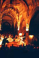 Whirling dervishes perform the Sena at the Caravanserai, Sarihan, Cappadocia, Turkey