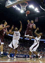 Virginia Tech Hokies forward Deron Washington (13) splits two SIU defenders on his way to the basket.  The #4 seed Southern Illinois Salukis defeated the #5 seed Virginia Tech Hokies 63-48 in the second round of the Men's NCAA Basketball Tournament at the Nationwide Arena in Columbus, OH on March 18, 2007.