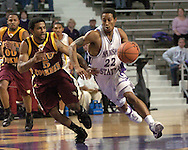 Kansas State guard Mario Taybron (R) drives up court against pressure from Bethune-Cookman guard Brandon Edwards (L), during K-State's 74-61 win over Buthune-Cookman at Bramlage Coliseum in Manhattan, Kansas, December 17, 2005.