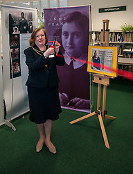 Edinburgh's Bailie Elaine Aitken opened Firrhill High School's 'The Anne Frank: A History For Today' exhibition  today. Baillie Aitken was joined by Heather Boyce from the Anne Frank Trust and second generation Holocaust survivors who spoke of their family members' memories of the war. The ceremony was attended by pupils from Firrhill High, local primary schools and retirement home residents from Old Farm Court and Caiystane Court. Councillor for Colinton and Fairmilehead, Bailie Aitken open the exhibition which shows how important is is for current and future generations to challenge predujice and value inclusion. 29 April 2014 (c) GER HARLEY | StockPix.eu