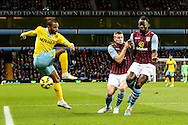 Jason Puncheon of Crystal Palace (left) fires a shot straight at Aly Cissokho of Aston Villa (right) during the Barclays Premier League match at Villa Park, Birmingham<br /> Picture by Andy Kearns/Focus Images Ltd 0781 864 4264<br /> 01/01/2015