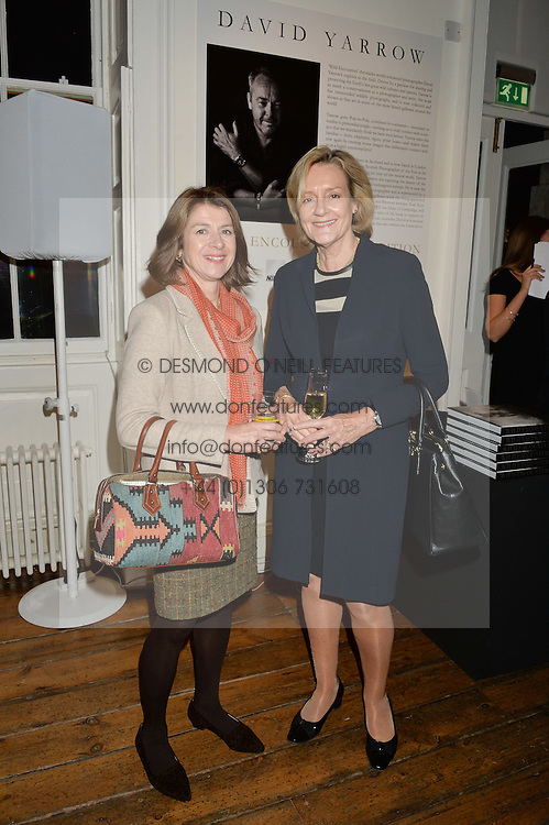 Left to right, MARIANNE FENTON and BARONESS BUSCOMBE at a private view of photographs by renowned wildlife photographer David Yarrow in aid of TUSK entitled 'Wild Encounters' held at Somerset House on 19th September 2016.